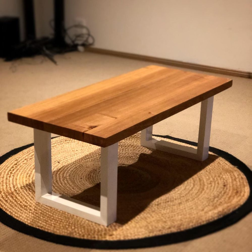 Coffee table top is made from old recycled messmate timber, glued together, with recycled framing timber, painted gloss white