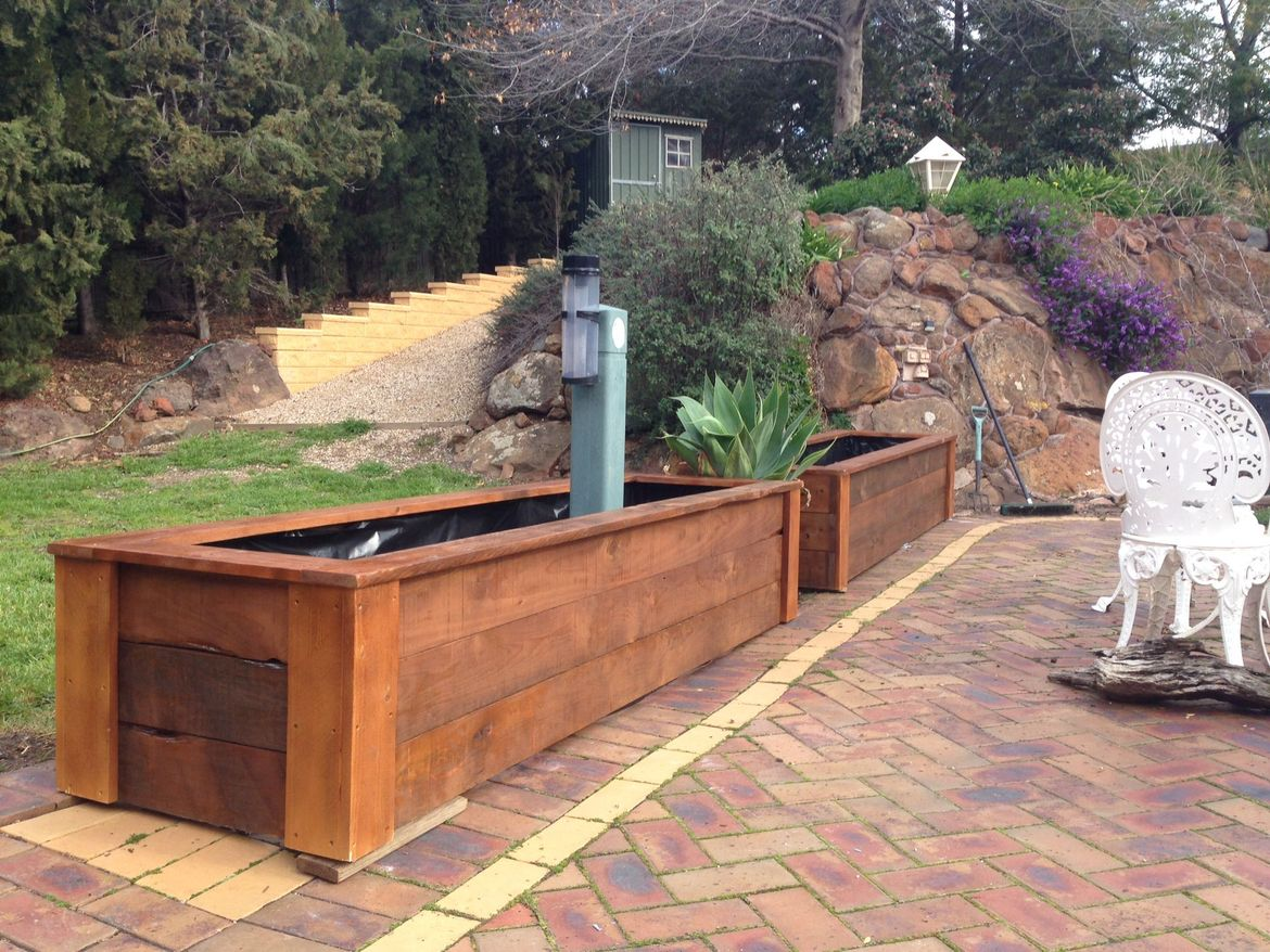 2.5m x 2 planter boxes, fitted over existing garden bed, lined with builders plastic ready for some plants.