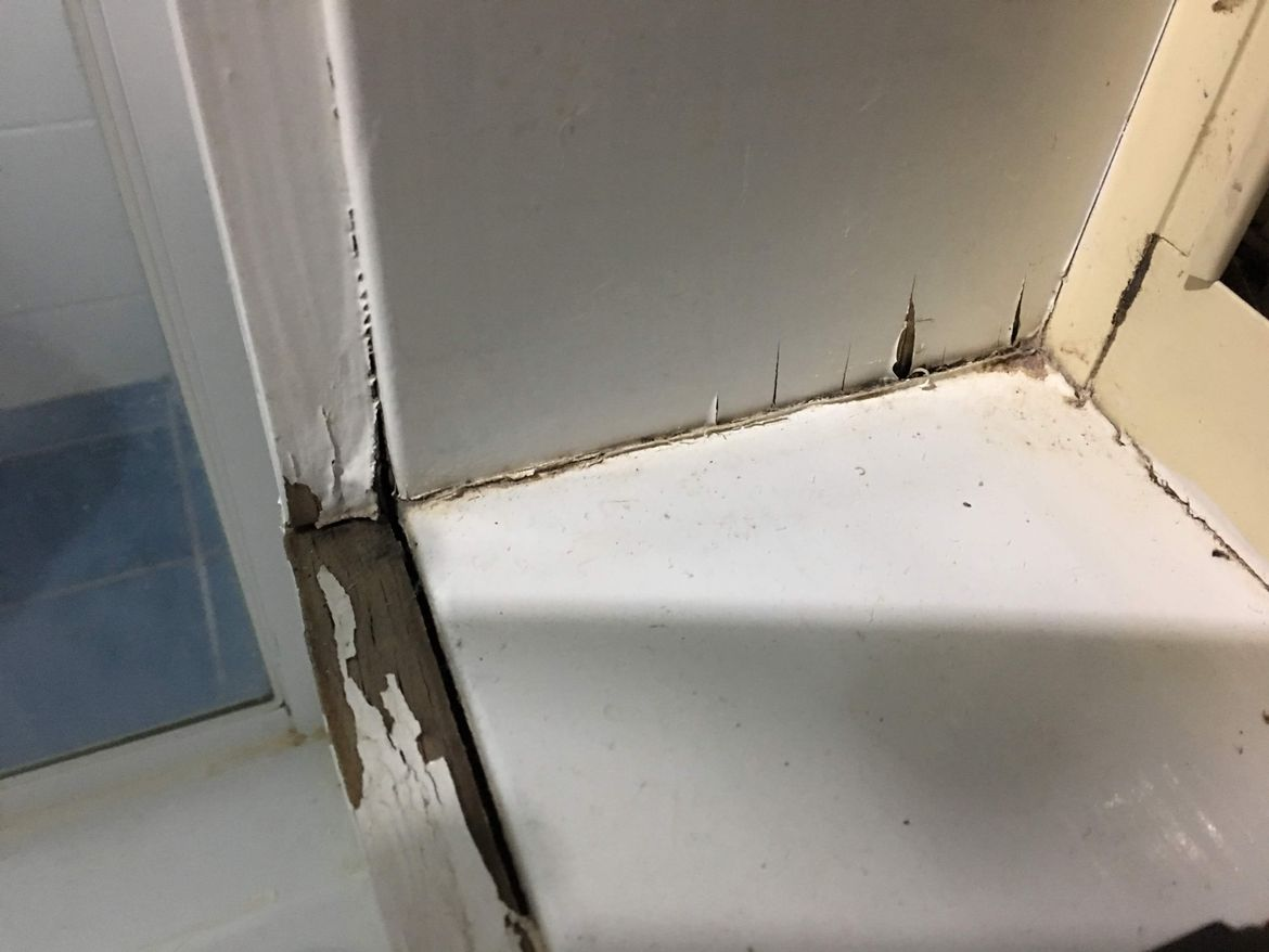 The water damaged window frame