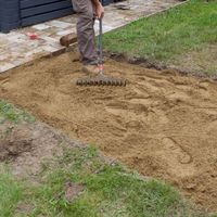 5.1 Spread paving sand with a rake.jpg
