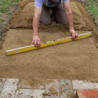 5.2 Use a screed bar to smooth and level the surface.jpg
