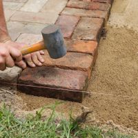 7. Start laying pavers from one edge.jpg