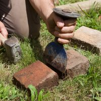 8. Cut bricks with a bolster and lump hammer.jpg