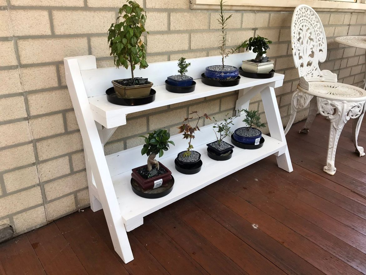 Plant stand was made from a discarded pine pallet.