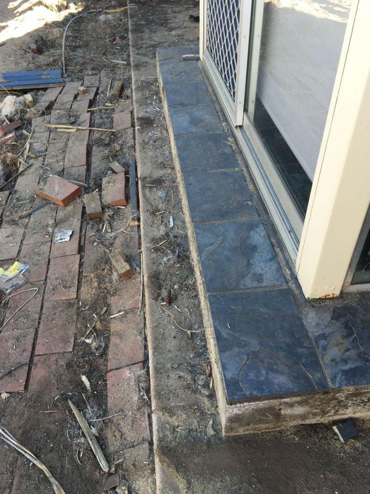 The deck will butt up to the rear doorway and tiles and the decking will be level and flush with it