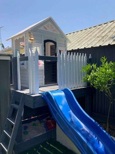 Fence pickets added and blue slide for a quick escape