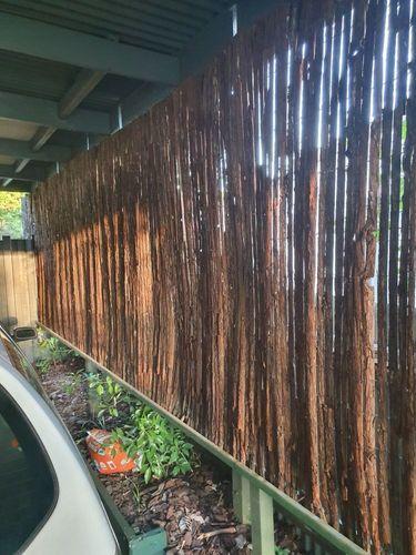 Fence rail + bark screening.