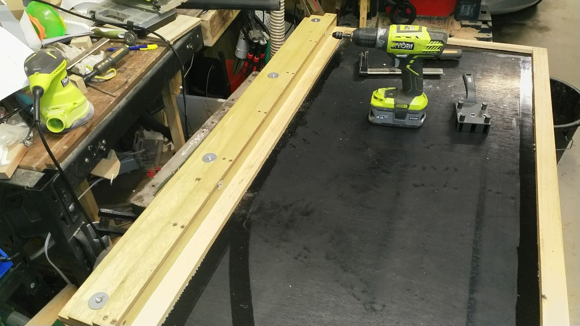 fence rail attached to table top