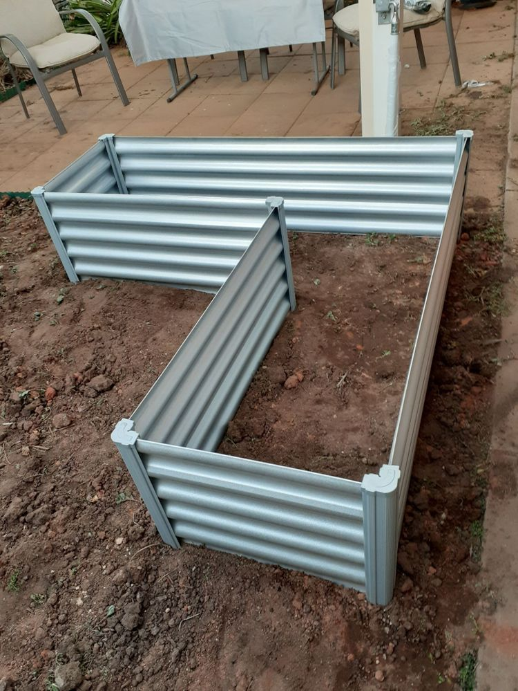 Assemble raised garden bed in a sunny position