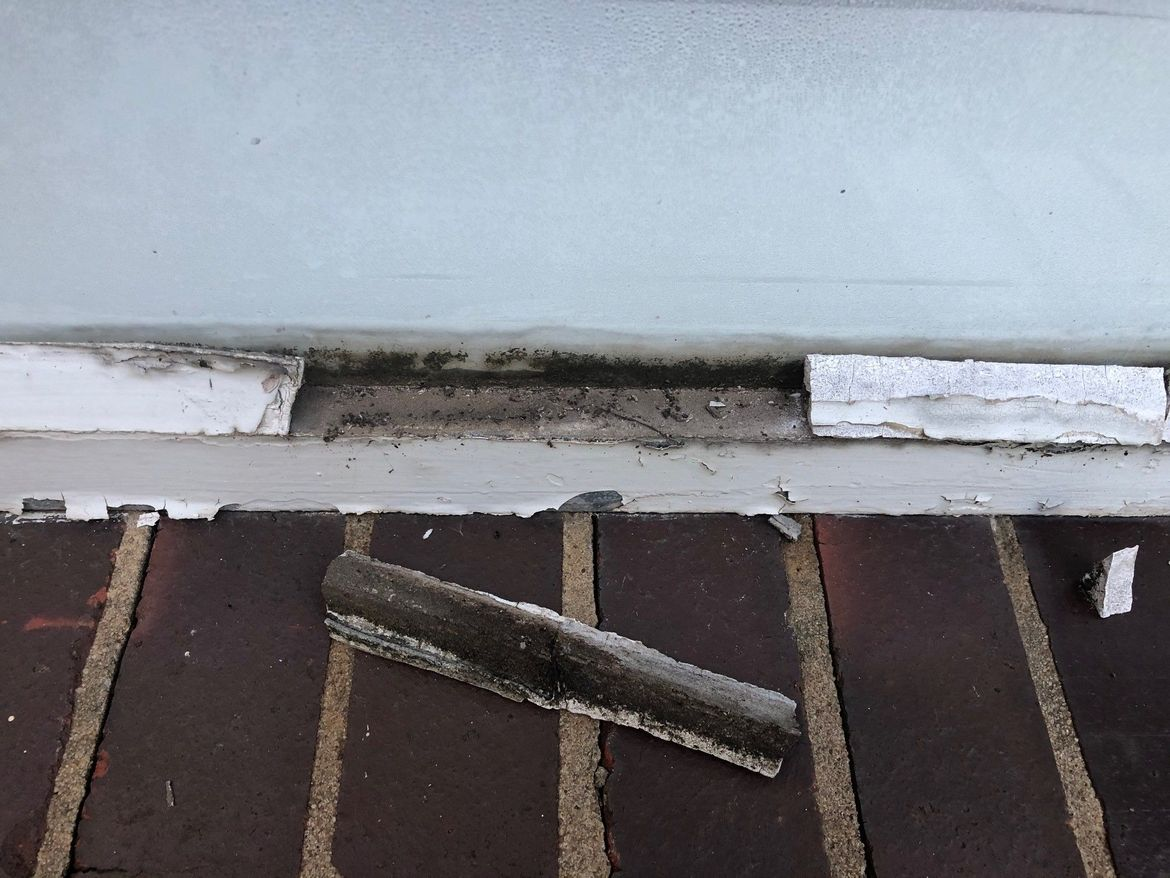 Window and frame with the putty that needs replacing