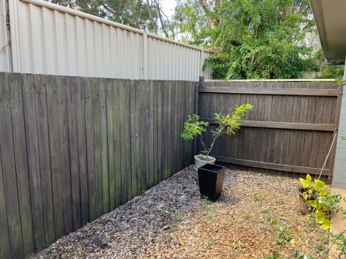 Before: back and side neighbour fence