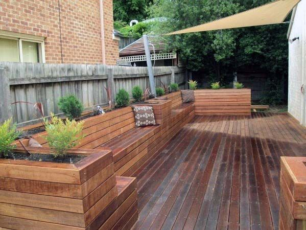 backyard-ideas-deck-bench-wood-with-planters.jpg