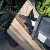 1.2 A reciprocating saws makes quick work of removing boards.jpg
