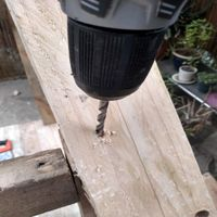 6.3 Pre-drill holes in roof supports to fix into vertical posts..jpg