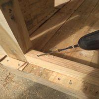 14.1 Install bottom fixing beam into position..jpg