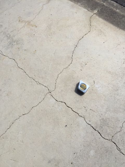 size of cracks in cement, measure tape for scale