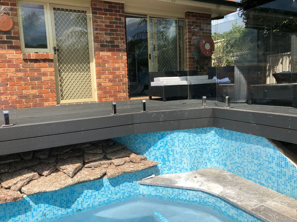 Tiles around pool and deck above