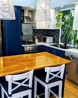 Heritage-style cabinets feature in this homely kitchen