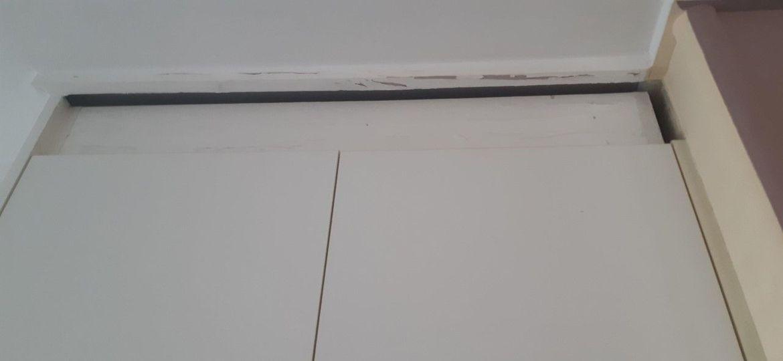 Above kitchen cupboards