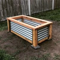 Raised garden bed using cypress and corrigated iron
