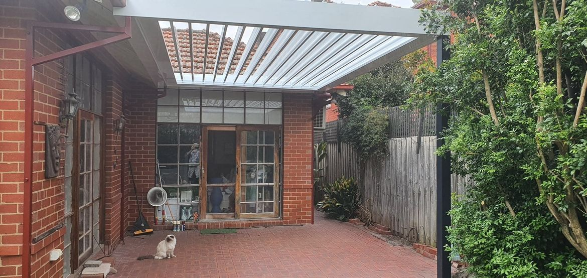 Contemplating decking over or instead of pavers, to raise level (~15cm) to match interior floor.