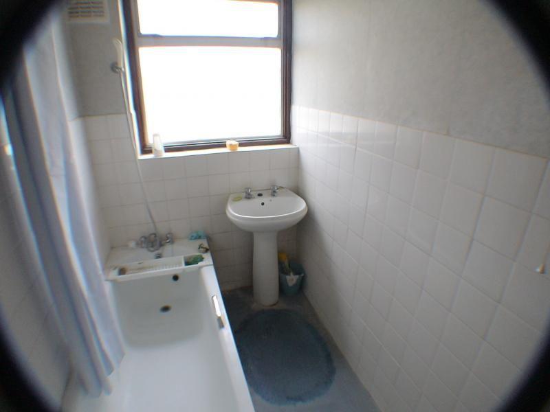old bathroom, toilet on otherside of wall.jpg