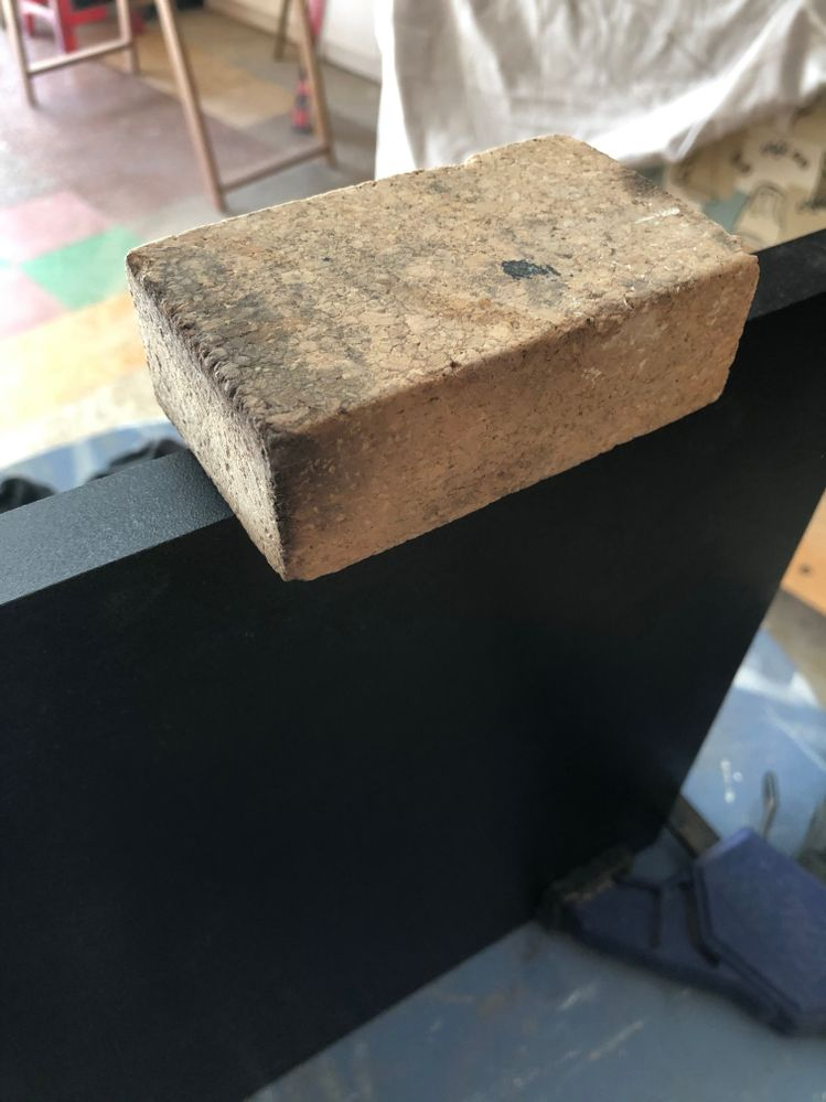 Cork block used to pressed heated edging on board
