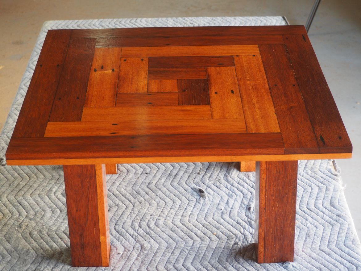 Coffee table crafted from recycled hardwood flooring, finished with hard wax oil.