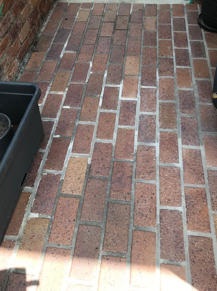 Grouting replaced in this section but colour of mortar varies.
