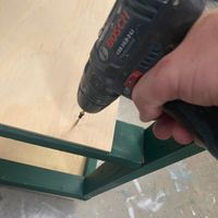 Step 7.5 Screw in shelves.jpg