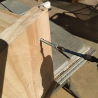 7.5 Fixing screws through side panel into shelf.jpeg