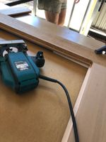 Cutting the paneling rebate with the router.