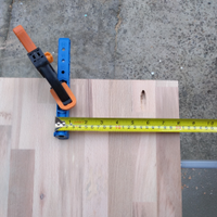2.4 Kreg guide clamped in position on middle of upright board.png