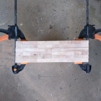 1.2 Upright boards clamped together for sanding.png