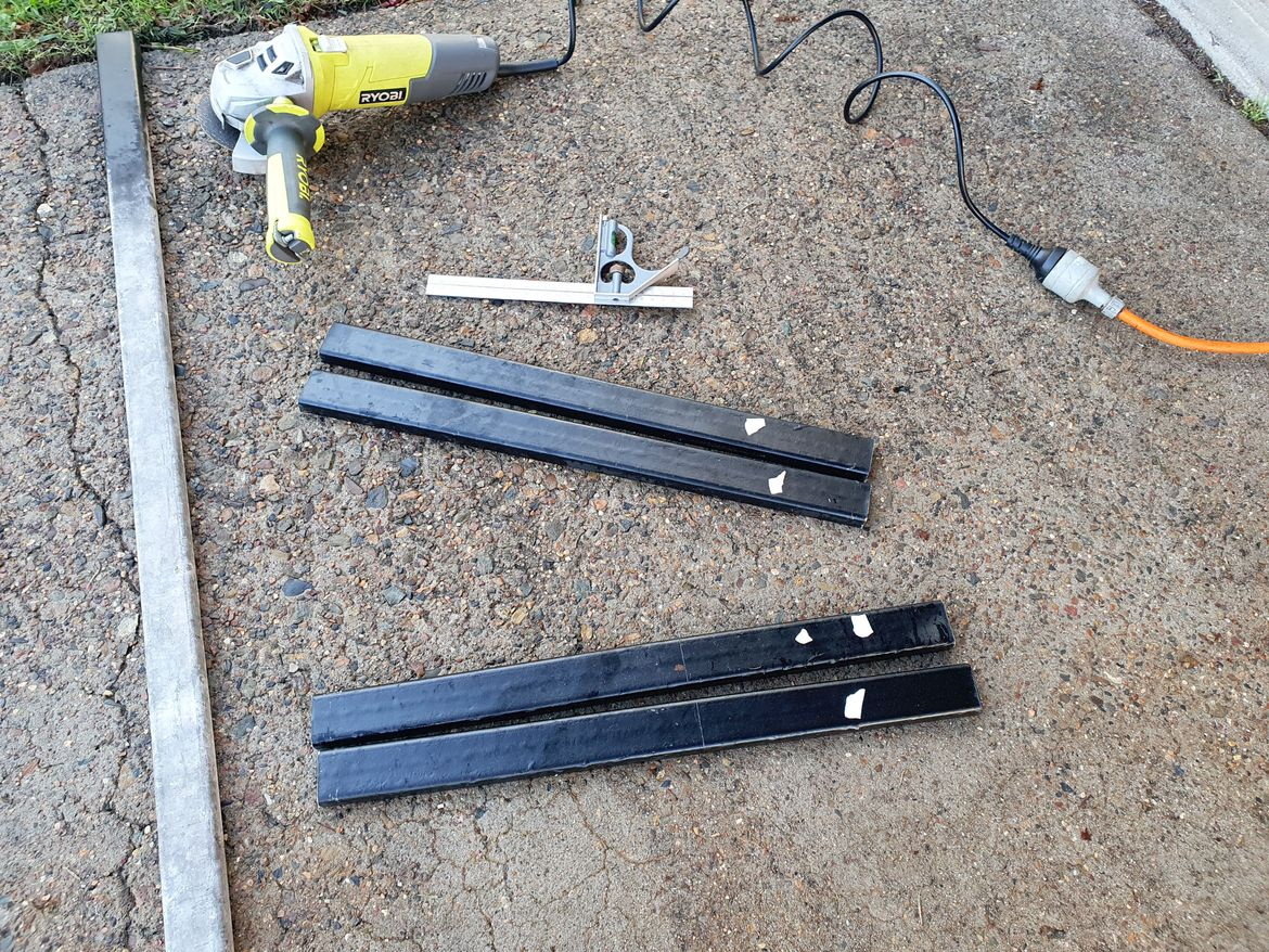 I had a length of steel I cut up and painted for use as brackets