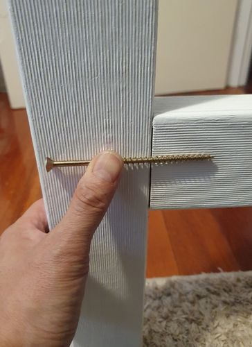 Fix two screws, upper and lower into the cross braces
