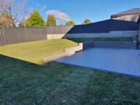 Completed project with simple deck and retaining wall.