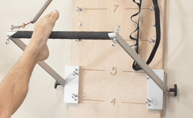 A commercially available Pilates Push Through Bar that I'm trying to replicate