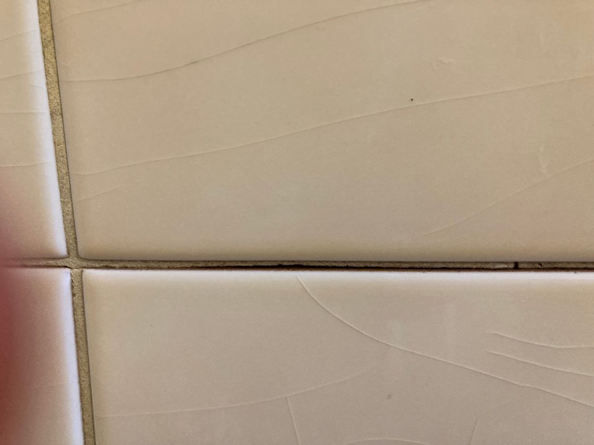 gap is just above bottom tile