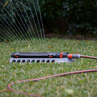 A sprinkler with adjustable throw makes watering more efficient.