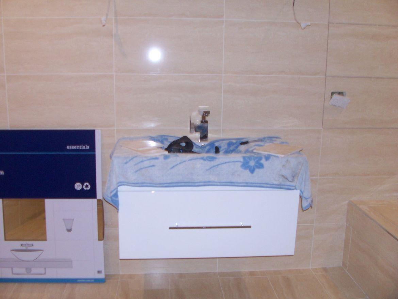 Bathroom Vanity Hung.JPG
