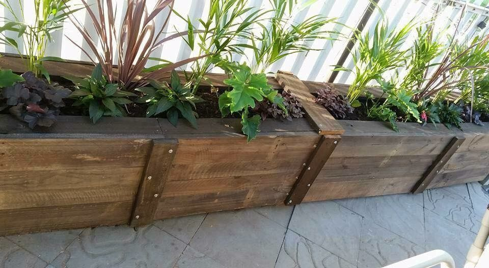 One of my first Pallet Planter Boxes. Two were joined, and finished with a home-made stain