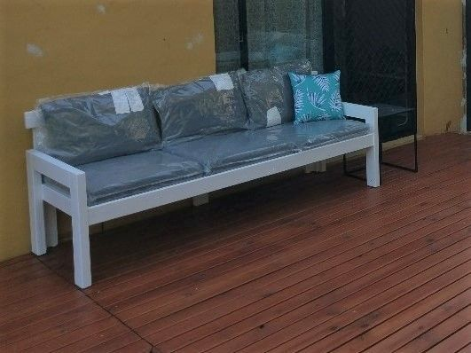 Outdoor sofa finished and painted with store bought cushions.
