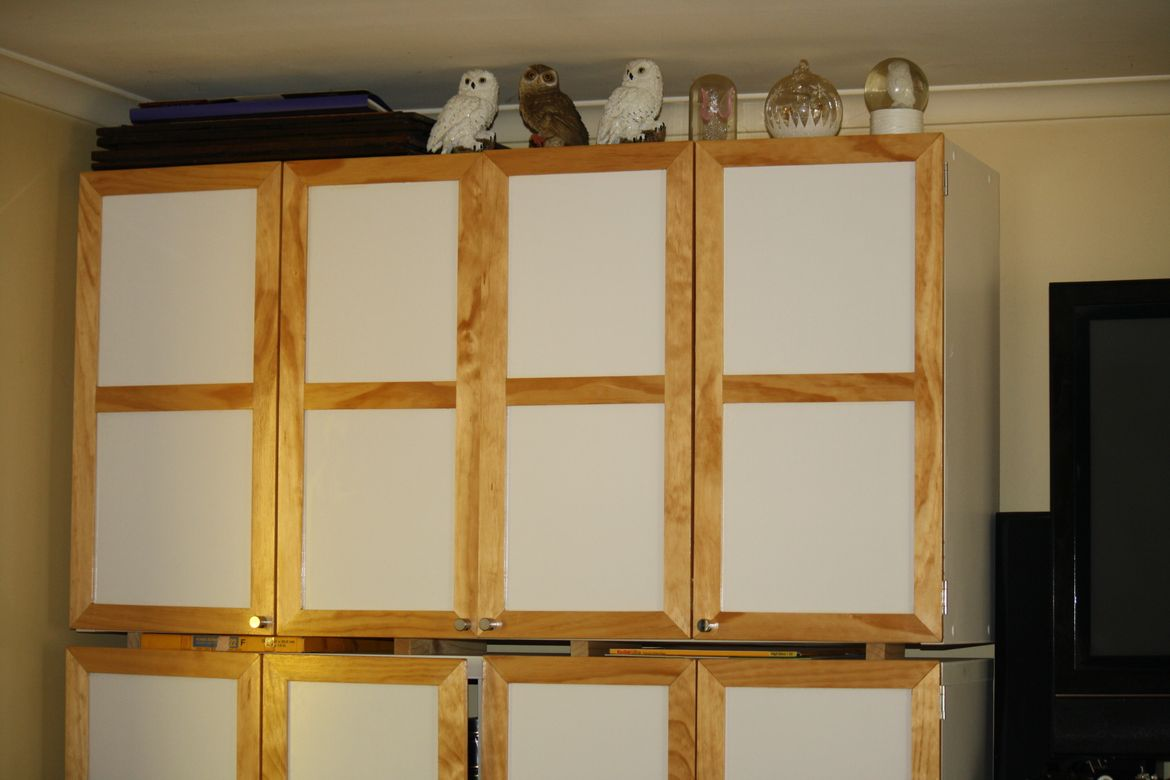 We purchased Cube Shelving from Bunnings & I made & added Bi-Fold Doors .
