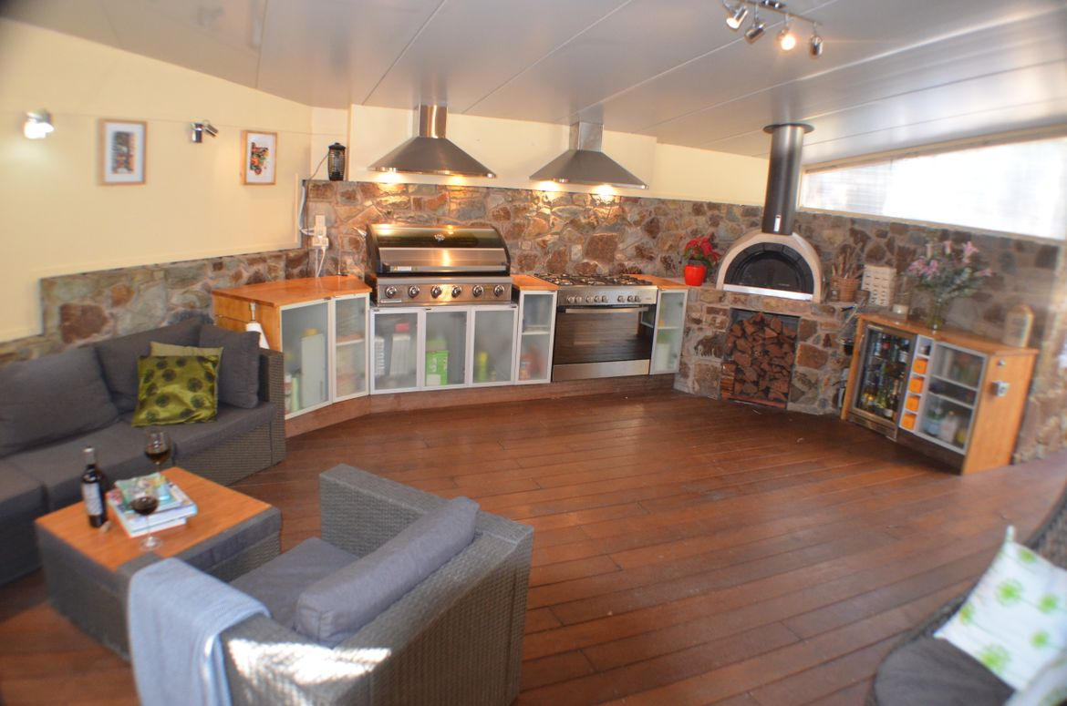 The outdoor kitchen has taken me some time to finish and has now given us a whole new room outside.