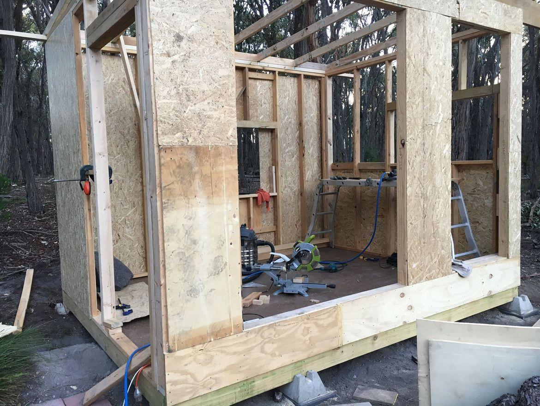 All walls. Roof joists underway.