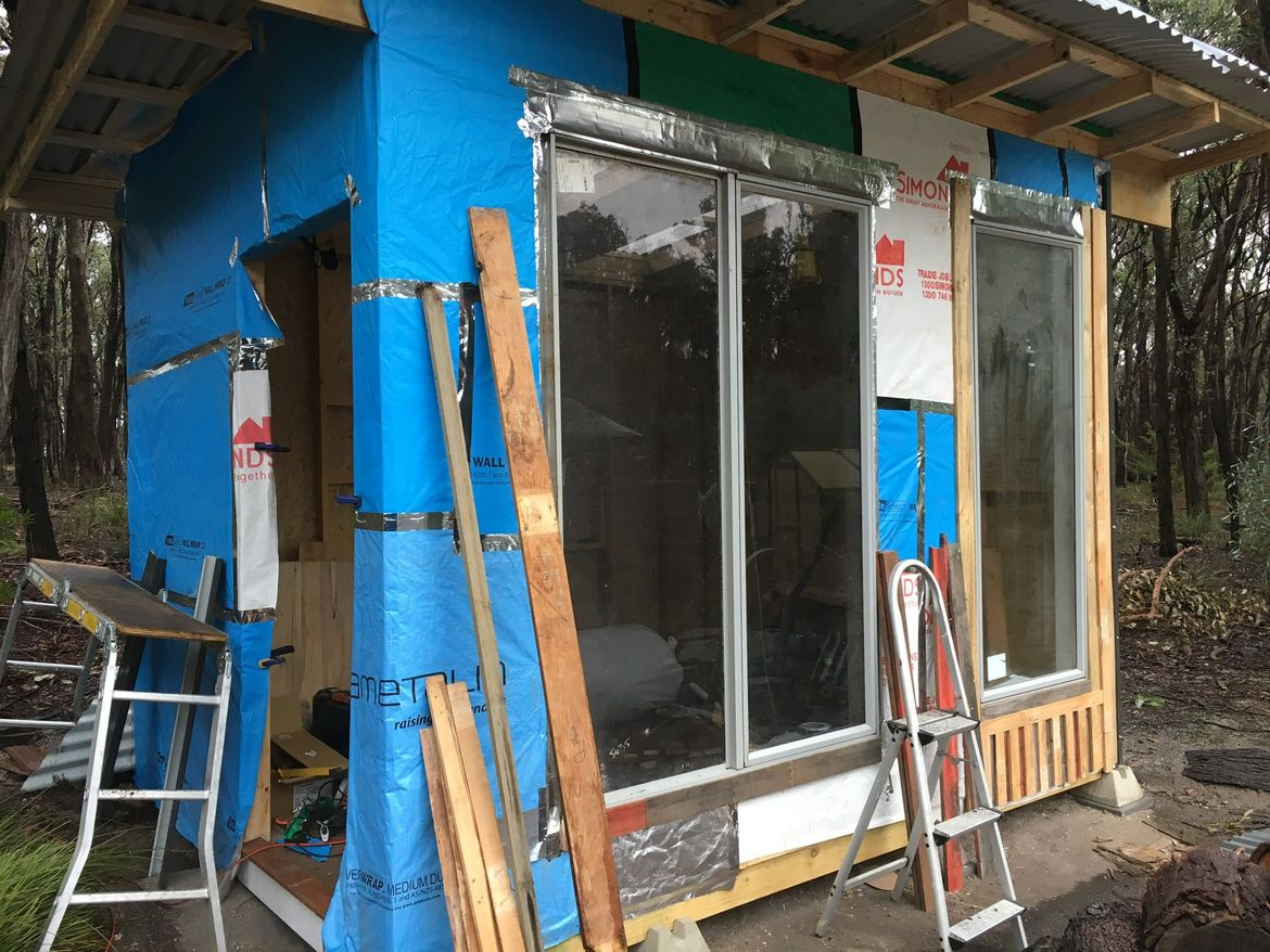 Patchwork house wrap, windows installed.