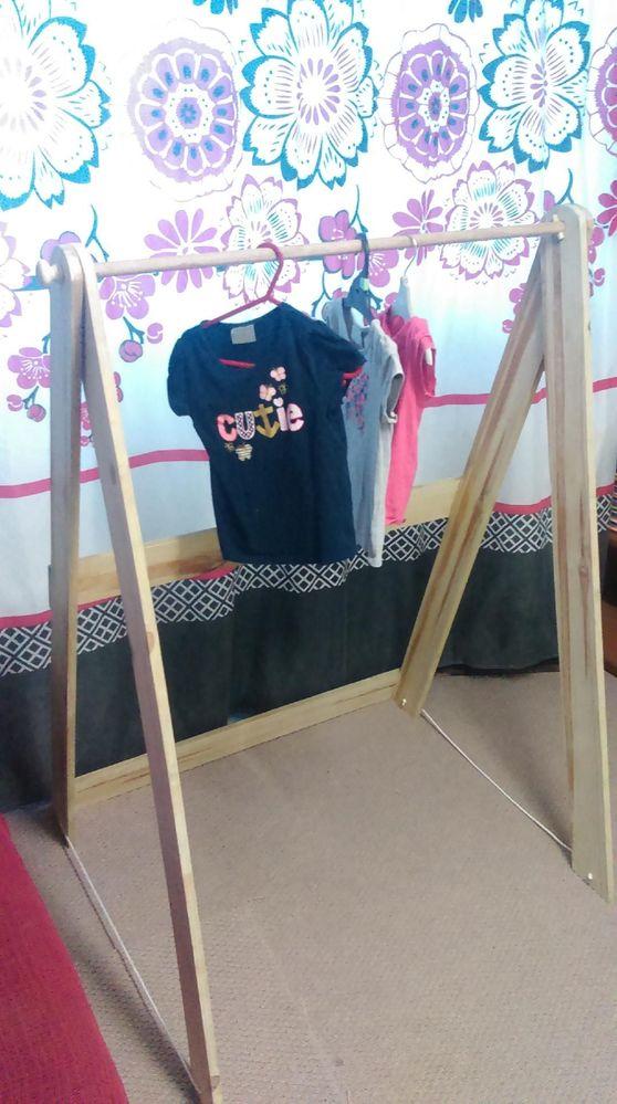 Folding clothes hanger.