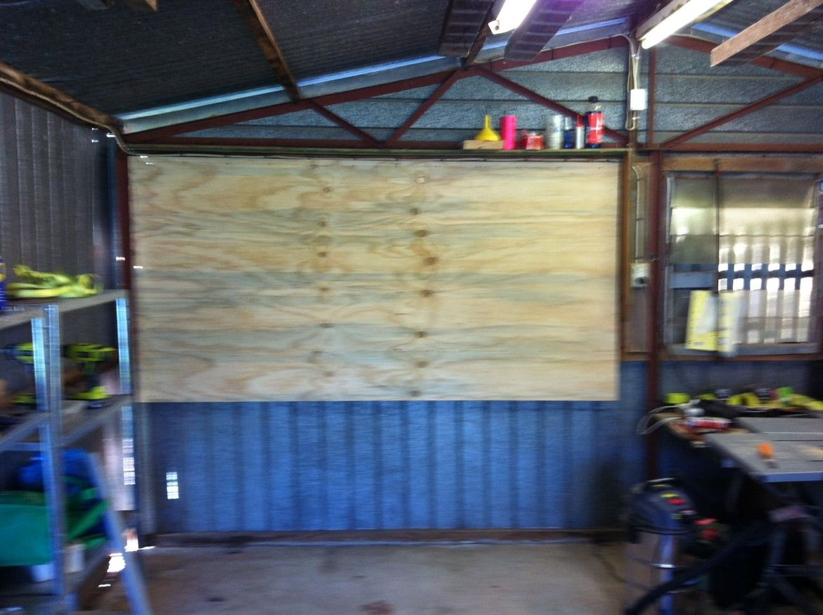 Plywood tool wall in place