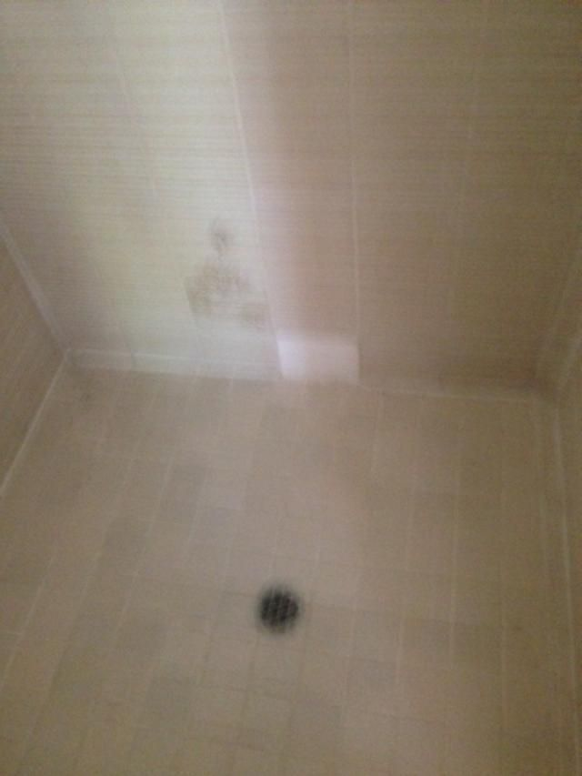 bad patch on tile wall of shower